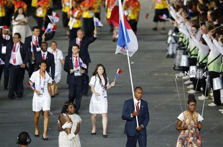 Panama's flag bearer Irving Saladino holds the national flag as he leads the contingent in the athletes parade during the opening ceremony of the London 2012 Olympic Games at the Olympic Stadium July 27, 2012. REUTERS/Mike Blake