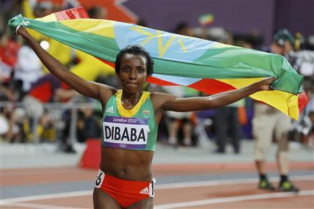 Ethiopia's Tirunesh Dibaba celebrates with her national flag after she won the women's 10,000m final at the London 2012 Olympic Games at the Olympic Stadium August 3, 2012. REUTERS/Phil Noble