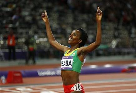Ethiopia's Tirunesh Dibaba celebrates after winning the women's 10,000m finals at the London 2012 Olympic Games at the Olympic Stadium August 3, 2012. REUTERS/Kai Pfaffenbach