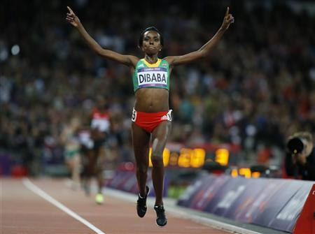 Ethiopia's Tirunesh Dibaba celebrates as she crosses the finish line in the women's 10000m final during the London 2012 Olympics Games at the Olympic Stadium August 3, 2012. REUTERS/Lucy Nicholson
