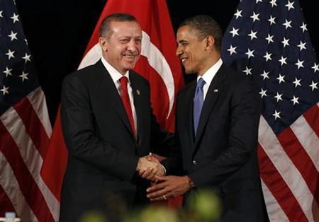 U.S. President Barack Obama (R) shakes hands with Turkey's Prime Minister Tayyip Erdogan after a bilateral meeting in Seoul March 25, 2012. REUTERS/Larry Downing