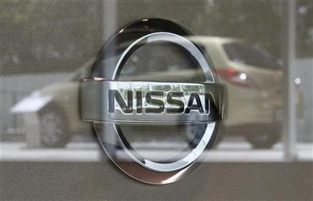 Nissan Motor Corp's logo is pictured as a Nissan vehicle is reflected on glass at the Nissan Gallery in Yokohama, south of Tokyo July 26, 2012. EUTERS/Yuriko Nakao