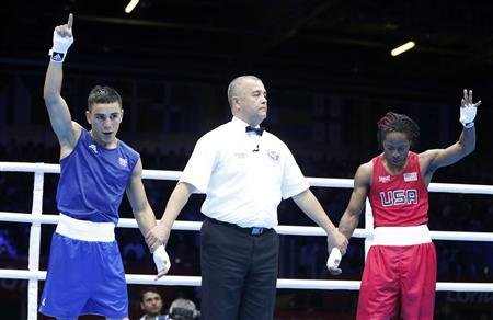 France's Nordine Oubaali (L) and his opponent Raushee Warren of the U.S. wait for the decision after their Men's Fly (52kg) Round of 16 boxing match during the London 2012 Olympic Games August 3, 2012. REUTERS/Murad Sezer