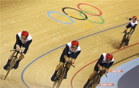 Britain's Ed Clancy, Geraint Thomas, Steven Burke and Peter Kennaugh sprint to the finish during the final lap in the track cycling men's team pursuit gold final at the Velodrome during the London 2012 Olympic Games August 3, 2012. REUTERS/Stefano Rellandini