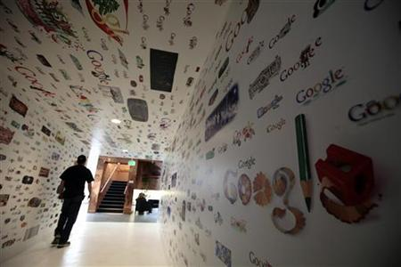A man walks through a tunnel of Google homepage logos at the Google campus near Venice Beach, in Los Angeles, California January 13, 2012. REUTERS/Lucy Nicholson