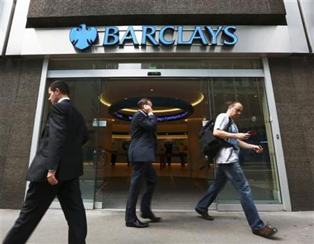 People walk past a branch of Barclays Bank in the City of London, June 28, 2012. REUTERS/Olivia Harris