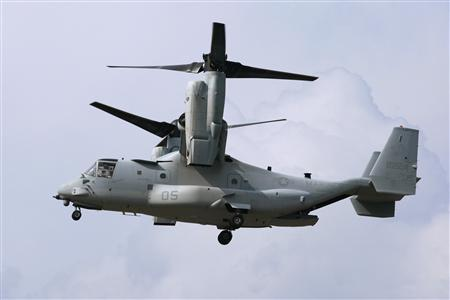 An MV-22 (Osprey) aircraft arrives for a test flight with the Japanese delegation at the Pentagon landing field in Washington August 3, 2012. REUTERS/Yuri Gripas