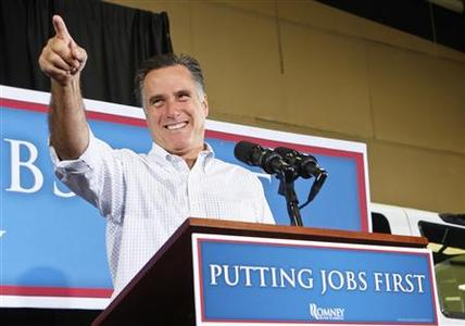 Republican presidential candidate Mitt Romney points to someone in the audience as he is greeted with cheers and applause at a campaign event held at Sierra Truck Body & Equipment, in North Las Vegas, Nevada, August 3, 2012. REUTERS/Christopher DeVargas/Las Vegas Sun