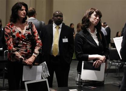 Jobseekers wait to speak to a recruiter during the Gemological Institute Of America (GIA)'s Jewelry Career Fair in New York in this file photo taken July 30, 2012. REUTERS/Shannon Stapleton/Files
