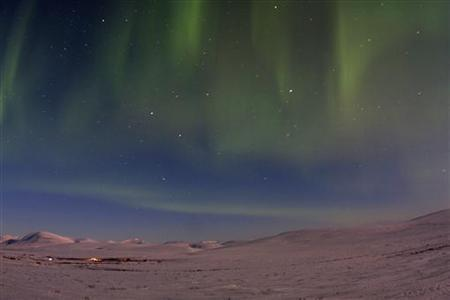 The aurora borealis is seen from Mile 7 on Beam Road above snow-covered tundras near Nome, Alaska March 10, 2012. A solar storm that shook the Earth's magnetic field on Thursday spared satellite and power systems as it delivered a glancing blow, although it could still intensify until early Friday, U.S. space weather experts said. REUTERS/Oscar Avellaneda-Cruz