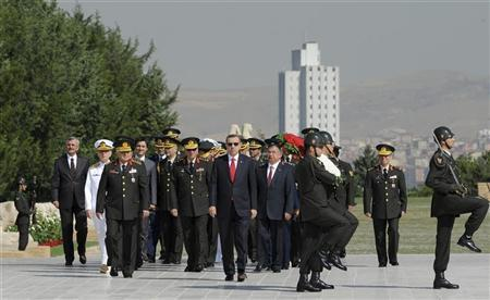 Turkey's Prime Minister Tayyip Erdogan (C) attends a wreath-laying ceremony with members of the High Military Council at the mausoleum of Mustafa Kemal Ataturk, founder of modern Turkey, in Ankara August 1, 2012. REUTERS/Stringer