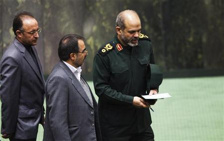 Iranian Defense Minister General Ahmad Vahidi (R) walks in parliament in Tehran November 1, 2011. REUTERS/Raheb Homavandi