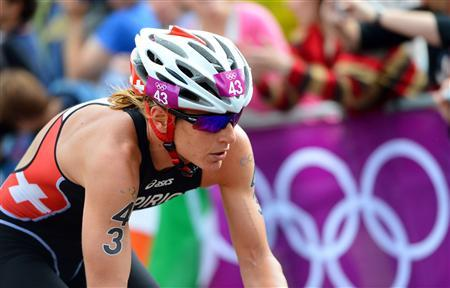 Nicola Spirig of Switzerland competes in the women's triathlon final during the London 2012 Olympic Games at Hyde Park August 4, 2012. REUTERS/Miguel Medina/Pool