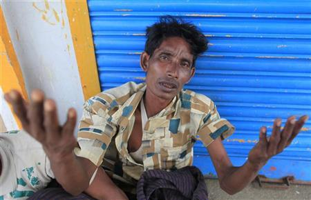 A Rohingyas man from Myanmar gestures after being arrested by Border Guards of Bangladesh (BGB) while trying to get into Bangladesh, in Teknaf June 18, 2012. REUTERS/Andrew Biraj
