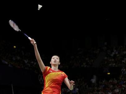 China's Li Xuerui returns a shot to compatriot Wang Yihan during their women's singles badminton gold medal match at the London 2012 Olympic Games at the Wembley Arena August 4, 2012. REUTERS/Toru Hanai