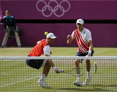 Mike Bryan (R) and Bob Bryan of the U.S. return to France's Jo-Wilfried Tsonga and Michael Llodra in their men's doubles tennis gold medal match at the All England Lawn Tennis Club during the London 2012 Olympic Games August 4, 2012. REUTERS/Mike Blake