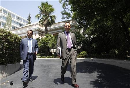 Greek Finance Minister Yannis Stournaras (R) and his alternate minister of finance Christos Staikouras leave the Prime Minister's office in Athens July 17, 2012. REUTERS/John Kolesidis (GREECE - Tags: POLITICS BUSINESS)