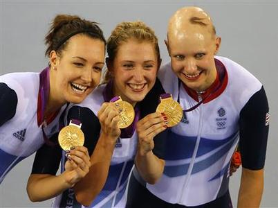 Britain's Dani King (L), Laura Trott (C) and Joanna Rowsell pose with their gold medals during the victory ceremony after the track cycling women's team pursuit gold finals at the Velodrome during the London 2012 Olympic Games August 4, 2012. Britain set a new world record of 3:14.051. REUTERS/Cathal McNaughton