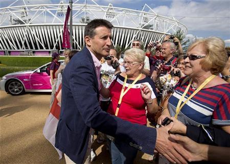 Olympic Games Chief Seb Coe greets members of the public near the Olympic stadium in London July 28, 2012. REUTERS/Neil Hall