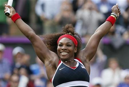 Serena Williams of the U.S. celebrates after winning the women's singles gold medal match against Russia's Maria Sharapova at the All England Lawn Tennis Club during the London 2012 Olympic Games August 4, 2012. REUTERS/Stefan Wermuth