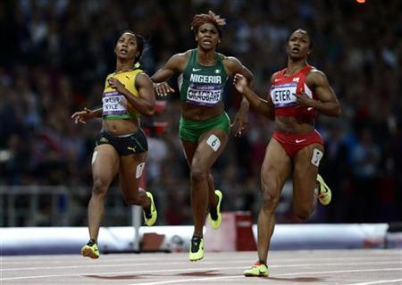 Jamaica's Shelly-Ann Fraser-Pryce (L), Nigeria's Blessing Okagbare (C) and Carmelita Jeter of the U.S. wait for their times after finishing the women's 100m finall at the London 2012 Olympic Games at the Olympic Stadium August 4, 2012. Fraser-Pryce was first while Jeter was second. REUTERS/Dylan Martinez