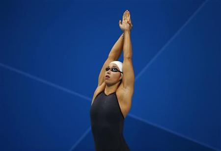 Netherlands' Ranomi Kromowidjojo prepares to swim in the women's 50m freestyle final during the London 2012 Olympic Games at the Aquatics Centre August 4, 2012. Kromowidjojo won the gold in the event with an Olympic record. REUTERS/Jorge Silva