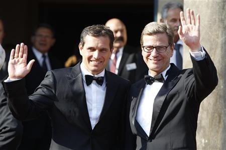 German Foreign Minister Guido Westerwelle and his partner Michael Mronz (L) arrive on the red carpet for the opening of the Bayreuth Wagner opera festival outside the Gruener Huegel (Green Hill) opera house in Bayreuth July 25, 2012. REUTERS/Michaela Rehle
