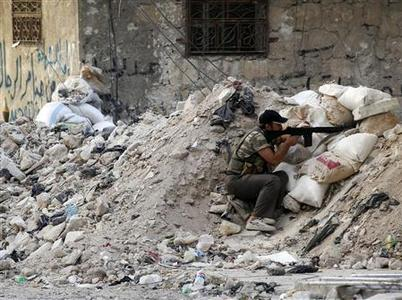 A Free Syrian Army fighter holds his rifle during clashes with Syrian Army soldiers in Salah al- Din neighbourhood in central Aleppo August 4, 2012. REUTERS/Goran Tomasevic