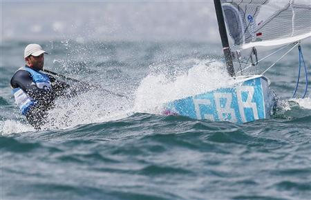 Britain's Ben Ainslie sails during the tenth race of the Finn sailing class at the London 2012 Olympic Games in Weymouth and Portland, southern England, August 3, 2012. REUTERS/Pascal Lauener