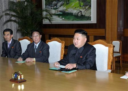 North Korean leader Kim Jong-Un (R) talks with Wang Jiarui (not seen in photo), the head of the International Liaison Department of China's Communist Party, during their meeting in Pyongyang August 2, 2012 in this picture released by the North's official KCNA news agency on August 3, 2012. REUTERS/KCNA
