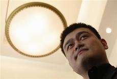 Former NBA basketball player Yao Ming attends a news conference in Hong Kong May 12, 2012. REUTERS/Bobby Yip