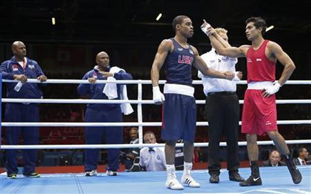 India's Krishan Vikas (R) is declared winner against Errol Spence of the U.S. in their Men's Welter (69kg) Round of 16 boxing match during the London 2012 Olympic Games August 3, 2012. REUTERS/Murad Sezer