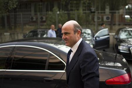 Spain's Economy Minister Luis de Guindos arrives for a conference organized by the Spanish newspaper La Razon in Madrid July 26, 2012. REUTERS/Juan Medina