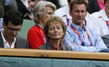 Swiss President Eveline Widmer-Schlumpf awaits the start of the men's singles tennis gold medal match between Britain's Andy Murray and Switzerland's Roger Federer at the All England Lawn Tennis Club during the London 2012 Olympic Games August 5, 2012. REUTERS/Stefan Wermuth