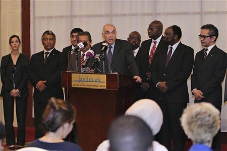 Egyptian Foreign Minister Mohamed Kamel Amr (C) talks to the media during a briefing in Amman August 5, 2012. Amr and other Non-Aligned Movement ministers held a news conference after the cancellation of a meeting of Non-Aligned Movement countries in the West Bank after Israel refused entry to several foreign envoys. An Israeli official said the envoys of Cuba, Indonesia, Malaysia and Bangladesh were denied transit as their nations do not recognise Israel. Envoys from 13 nations were to meet to discuss Palestinian plans for upgraded membership of the United Nations. REUTERS/Muhammad Hamed