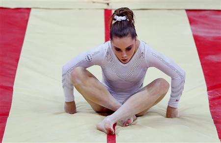 McKayla Maroney of the U.S. reacts after falling from the vault in the women's gymnastics vault final in the North Greenwich Arena during the London 2012 Olympic Games August 5, 2012. REUTERS/Mike Blake