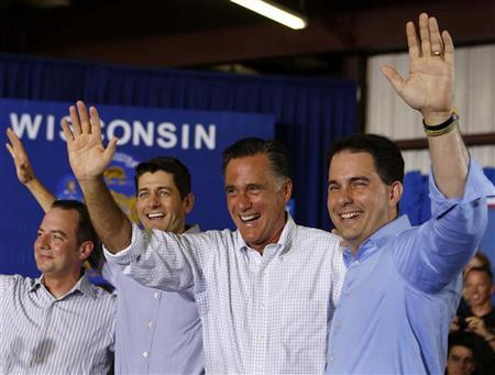 U.S. Republican Presidential candidate Mitt Romney (2nd R) waves next to Governor Scott Walker (R), Representative Paul Ryan (2nd L), and RNC Chairman Reince Priebus (L) before speaking to a crowd at Monterey Mills in Janesville, Wisconsin, June 18, 2012. REUTERS/Larry Downing