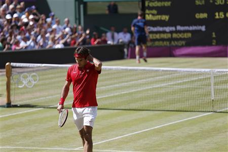 Switzerland's Roger Federer pauses during the men's singles tennis gold medal match against Britain's Andy Murray (rear) at the All England Lawn Tennis Club during the London 2012 Olympic Games August 5, 2012. REUTERS/Dominic Ebenbichler
