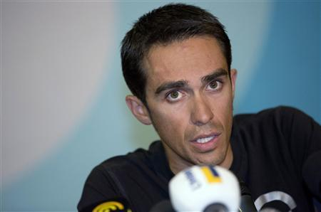 Team Saxo Bank rider Alberto Contador of Spain answers questions during a news conference in Gilze-Rijen August 5, 2012. Former Tour de France winner Contador, who has been banned from cycling for two years by the Court of Arbitration for Sport (CAS) for doping, makes his come back in the Eneco Tour which starts on August 6. REUTERS/Michael Kooren