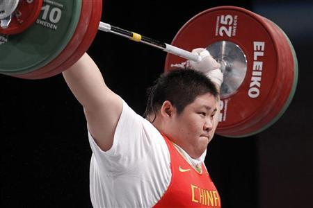 Zhou Lulu of China competes in the women's +75kg weightlifting competition during the World Weightlifting Championships at Disney Village in Marne-la-Vallee outside Paris, November 13, 2011. REUTERS/Benoit Tessier