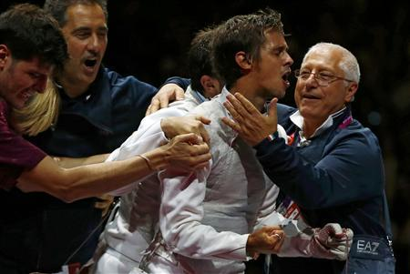 Italy's Andrea Baldini (2nd R) celebrates with team members their victory against Japan after the men's foil team gold medal fencing competition at the ExCel venue at the London 2012 Olympic Games August 5, 2012. REUTERS/Grigory Dukor