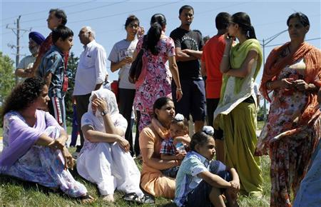 Members of the Sikh Temple wait for news following a mass shooting that left seven persons dead including the shooter in Oak Creek, Wisconsin August 5, 2012. REUTERS-Allen Fredrickson