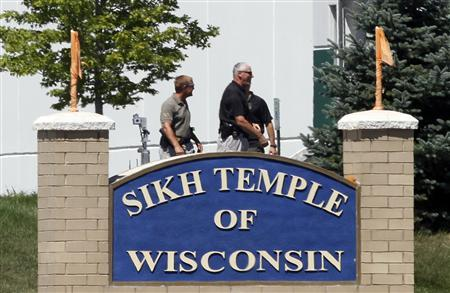 Officials gather near the Sikh Temple in Oak Creek in Wisconsin August 5, 2012 following a mass shooting inside and outside the Sikh Temple. REUTERS-Allen Fredrickson