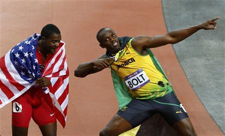Jamaica's Usain Bolt (R) celebrates winning the men's 100m final with third place finisher Justin Gatlin of the U.S. during the London 2012 Olympic Games at the Olympic Stadium August 5, 2012. REUTERS/David Gray