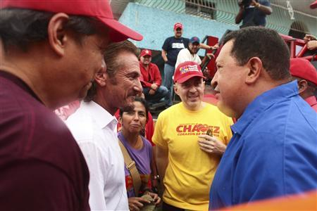 Venezuela's President Hugo Chavez (R) talks to U.S. actor Sean Penn during an election rally in Valencia, some 150 km (93 miles) west from Caracas August 5, 2012. REUTERS/Miraflores Palace/Handout