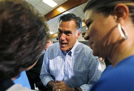 U.S. Republican presidential candidate Mitt Romney talks to two women after a campaign event in Golden, Colorado August 2, 2012. REUTERS/Rick Wilking