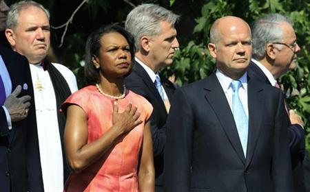 Former U.S. Secretary of State Condoleezza Rice (2nd L) and Britain's Foreign Secretary William Hague (2nd R) listen to the U.S. national anthem at the unveiling of a statue of former President Ronald Reagan outside the U.S. embassy in London July 4, 2011. REUTERS/Suzanne Plunkett