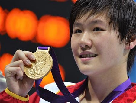 China's Ye Shiwen poses with her gold medal after winning the women's 200m individual medley final during the London 2012 Olympic Games at the Aquatics Centre July 31, 2012. REUTERS/Toby Melville