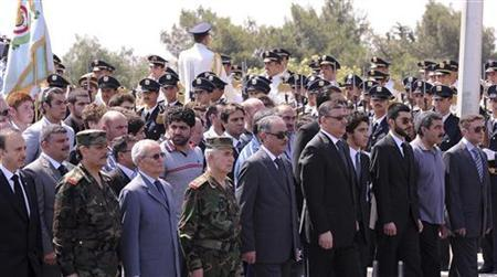 Syria's Vice President Farouk al-Shara (2nd L), Prime Minister Riyad Hijab (5th L), Assistant Secretary of the ruling Baath Party in Syria Mohammed Saeed Bekheitan (4th R), current Defense Minister General Fahad Jassim al-Freij (L) and other senior officials attend a national funeral for veteran army general Hassan Turkmani, Defence Minister Daoud Rajha and Assef Shawkat, the brother-in-law of Syrian President Bashar al-Assad, at the Unknown Soldier Monument in Damascus July 20, 2012, in this handout photograph released by Syria's national news agency SANA. REUTERS/Sana/Handout