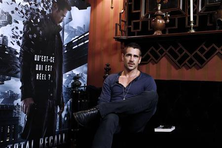 Irish actor Colin Farrell poses during a photocall as part of the presentation of the film ''Total Recall'' in Paris July 9, 2012. REUTERS/Jacky Naegelen